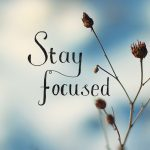 Wallpaper of snow with Stay Focused lettering