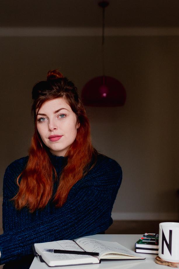 Self-portrait of Noukka Signe at her desk